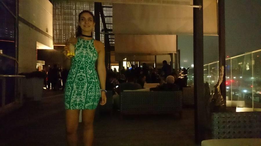 Backpacker girl holds drink in Ovo casino bar nightlife in Punta del Este Uruguay