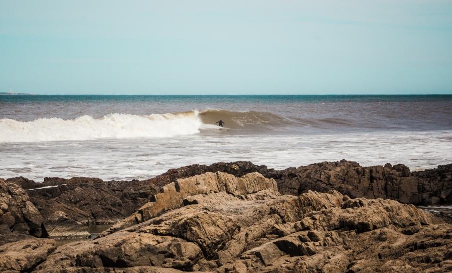 Surfer tackles huge wave at La Barra near Punta del Este Uruguay