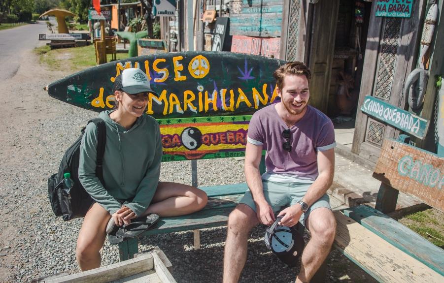 Couple smiling at Museo de Marihuana in La Barra near Punta del Este Uruguay