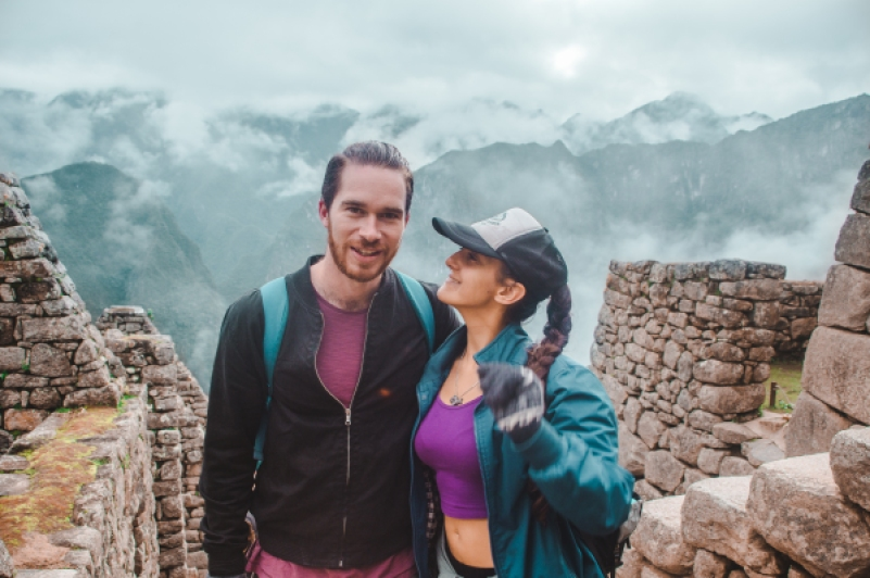 hidroelectrica to aguas calientes machu picchu trek trail hike walk along rail train tracks in peru cheapest way to get to machu picchu fog mist Machu Picchu from Cusco